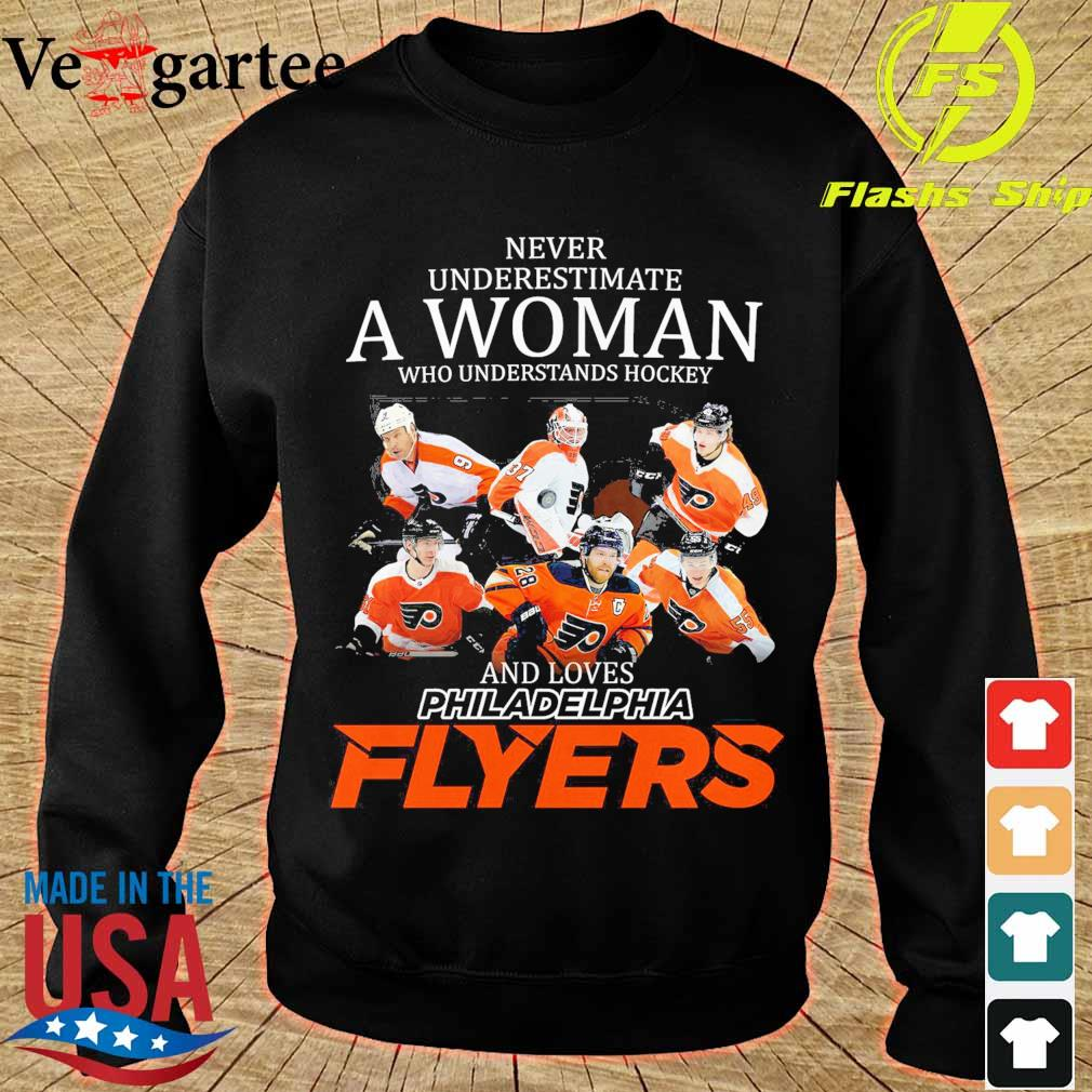 Never underestimate a woman who understands hockey and love Philadelphia Flyers s sweater