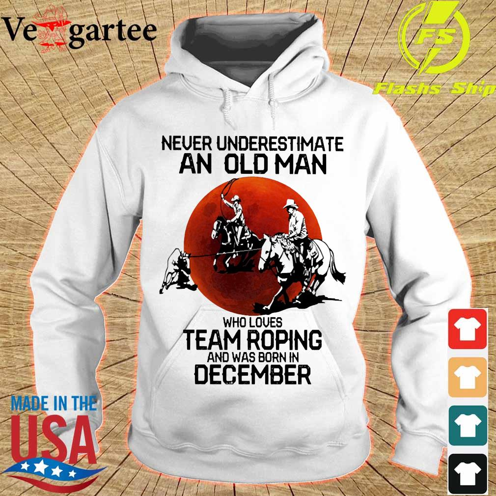 Never underestimate an old woman who loves team roping and was born in december s hoodie