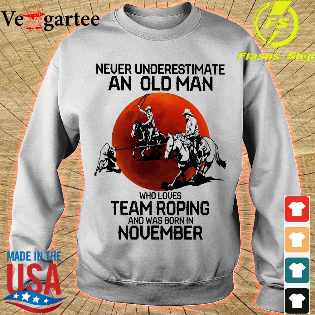 Never underestimate an old woman who loves team roping and was born in november s sweater